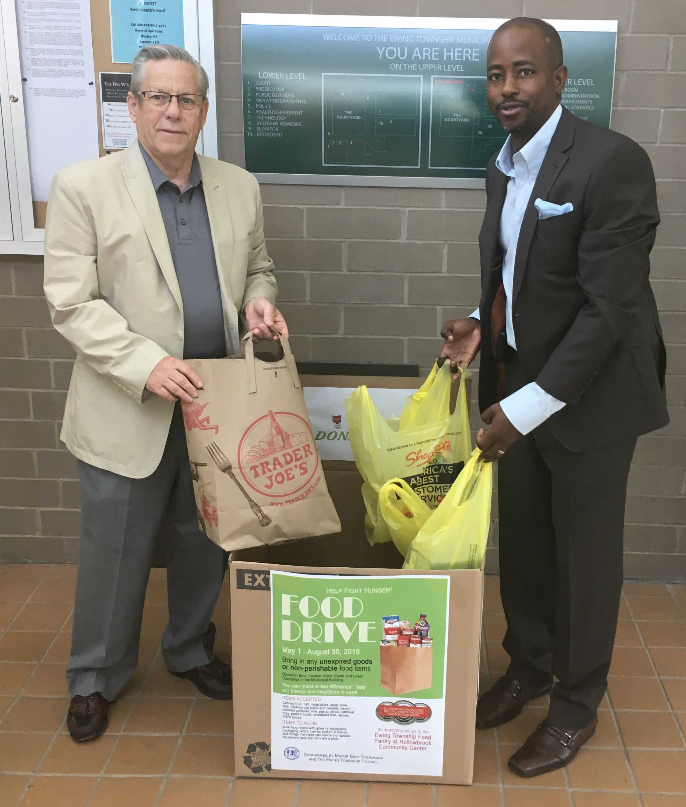 Food Drive drop off box in front lobby with Mayor Steinmann and Council President Baxter